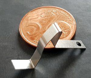 Technische Feder - Vergleich 5 Cent Münze